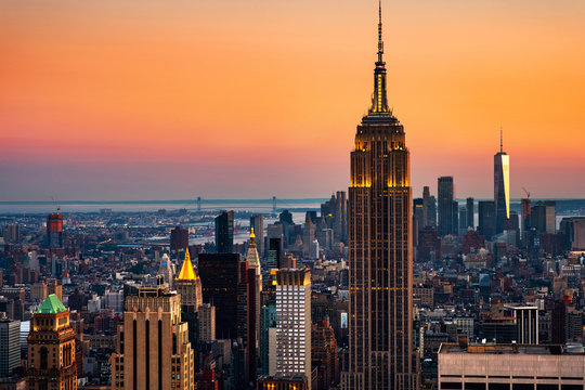 Aerial view on the city skyline in New York City, USA at sunset