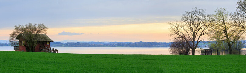Shore of the lake Zug in the spring during sunset. Zug, Switzerland.