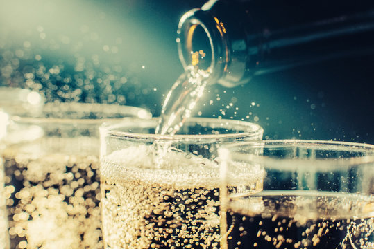 Party and holiday celebration concept. Many glasses of champagne on the table. Toned image.