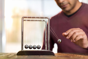 Concept For Action and Reaction in Business With Newton's Cradle
