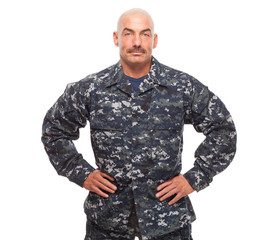 Navy sailor or chief looking serious on white background.
