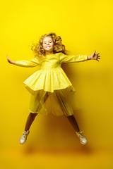 jumping girl in yellow