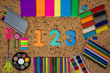 School supplies and numbers on an abstract background
