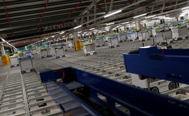 """Bots"" are seen on the grid of the ""smart platform"" at the Ocado CFC (Customer Fulfilment Centre) in Andover"