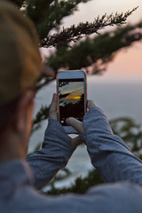 Woman Taking Photo on Smartphone