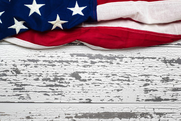 American flag on a white worn wooden background with copy space