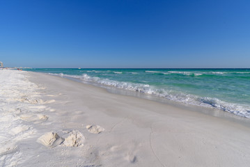 Gulf of Mexico emerald green and blue water washing on shore in waves