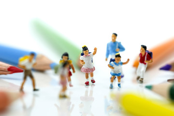 Miniature people : children and student with colorful drawing tools and stationary,education concept.