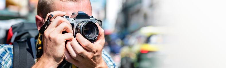 Tourist photographer taking photo in Khao san road Bangkok, Thailand