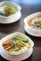Bowls of pork noodle soup on the table