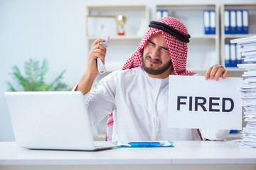 Arab man sitting at desk with message