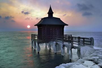 Bathhouse on pier with icicle in winter at sunrise, Lake Neuchatel, Gorgier, Canton Neuchatel, Switzerland, Europe