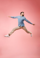 Full length of a joyful young man jumping