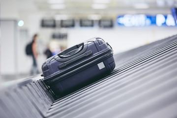 Suitcase on baggage claim