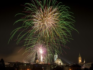 Fireworks over Schwaz on New Year's Eve with hospital church and parish church, Schwaz, Tyrol, Austria, Europe