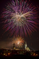 Fireworks over churches at night