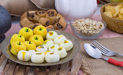Indian Mix Sweet Food Apple Shaped Peda With White Peda Also Know as pedha, pera or peday is a prepared in thick, semi-soft pieces. the main ingredients are khoya, sugar