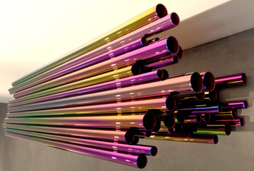 Metal tubing/pipes of multiple sizes and with coloring in horizontal design arrangement