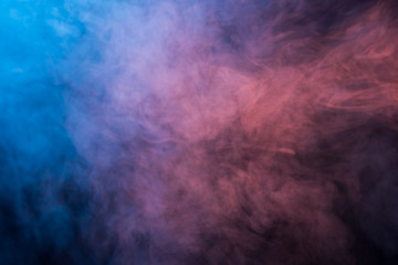 Abstract blue and pink smoke on a dark background