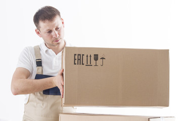 loader in uniform puts cardboard box isolated on white background. Caucasian male relocation service worker holds box. Mover holding cardboard box