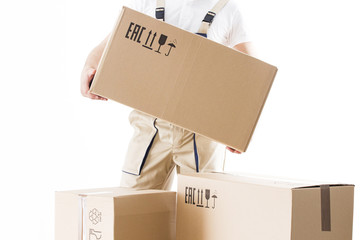 Relocation service man holds cardboard box in hand closeup isolated on white background. Loader worker with box.