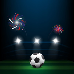 Soccer ball on green lawn with firework at night