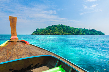 Wall Mural - View on turquoise clear water and traditional wooden boat in Bamboo island, Phi Phi, Thailand