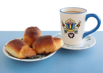 sweet buns with jam and coffee for breakfast