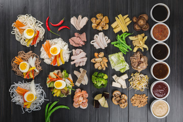 Assorted ingredients for cooking wok. Rice, noodles, meat, seafood, vegetables and sauces. Top view.