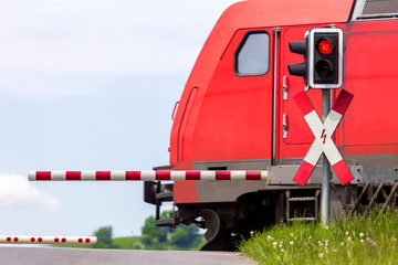 closed railroad crossing with passing train