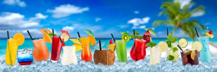 various colorful cocktails in crushed ice cubes isolated on palm beach backround beverages alcoholic drinks panorama banner