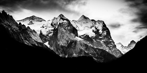 Dramatic mountain range with snow on peaks - Black and white