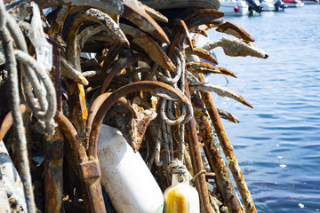 Old and rusty anchors in Harbor
