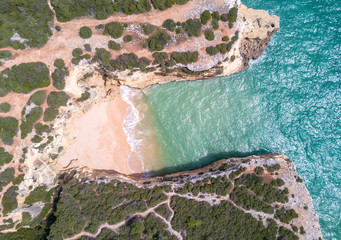 Wall Mural - Aerial view of sandy beach and ocean with beautiful clear turquoise water.