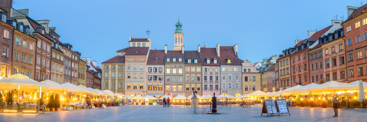 Panorama of old town square in Warsaw at lovely summer evening