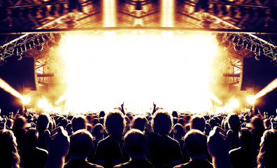 Live event stage lit with people attending the concert