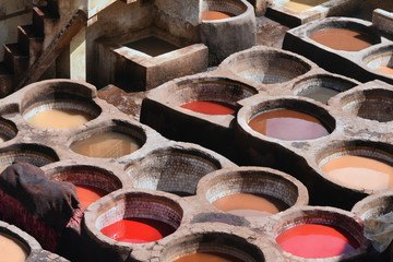 Round baths for painting the skin on traditional Moroccan dye with a liquid of red, brown, yellow flowers, Morocco.