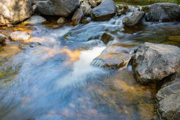 Mountain spring water, stream between rocks and stones, brook, creek. Thailand, island Koh Chang.