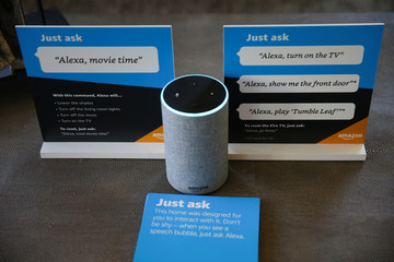 Prompts on how to use Amazon's Alexa personal assistant are seen alongside an Amazon Echo in an Amazon 'experience center'  in Vallejo