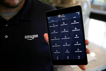 Amazon Expert Philippe Ferrey displays a list of smart devices in the Amazon Alexa app on an iPad in an Amazon 'experience centre' in Vallejo