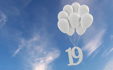 Number 19 party celebration. Number attached to a bunch of white balloons against blue sky