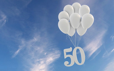 Number 50 party celebration. Number attached to a bunch of white balloons against blue sky