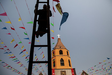 A man decorates a government-sanctioned Catholic church a day before Easter in Youtong village, Hebei province