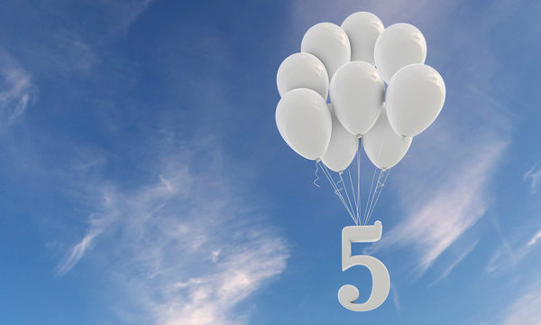 Number 5 party celebration. Number attached to a bunch of white balloons against blue sky