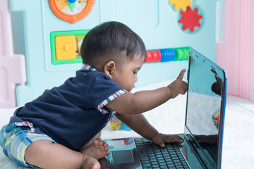 Cute little baby  play computer