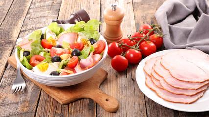 Fotobehang - vegetable salad with ham