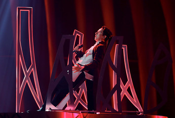 """Ukraine's MELOVIN performs """"Under the Ladder"""" during the dress rehearsal of Semi-Final 2 for Eurovision Song Contest 2018 at the Altice Arena hall in Lisbon"""