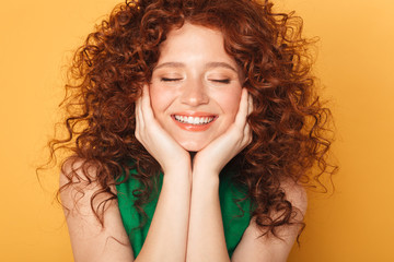 Close up portrait of a smiling curly redhead woman