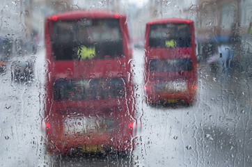 Public buses in during rainy weather, London, England