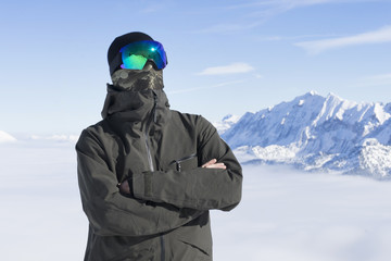 Skier in full covered face with ski goggles and fabric